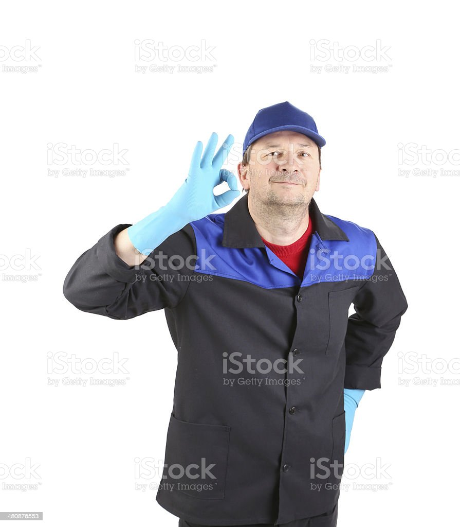 Man in blue gloves show ok sign. royalty-free stock photo