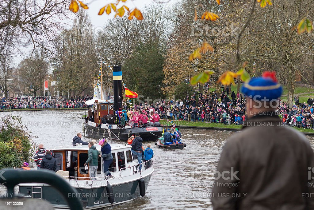 Man in blue hat watching arrival of the boats of Sinterklaas stock photo