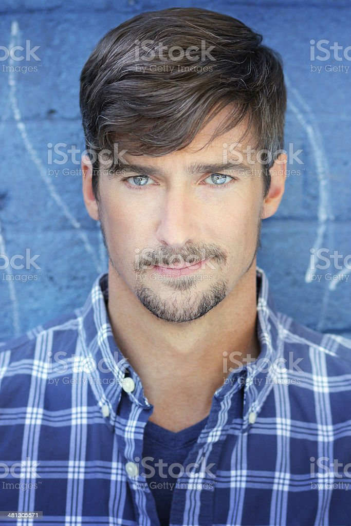 Man in blue stock photo