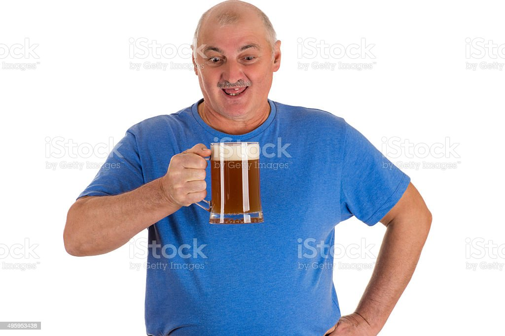 man in blue shirt with mug of beer in hand stock photo
