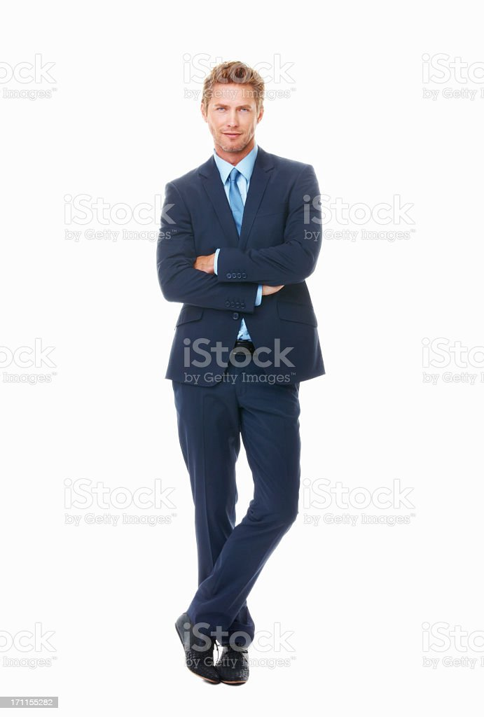 Man in blue suit and tie with arms folded and legs crossed stock photo