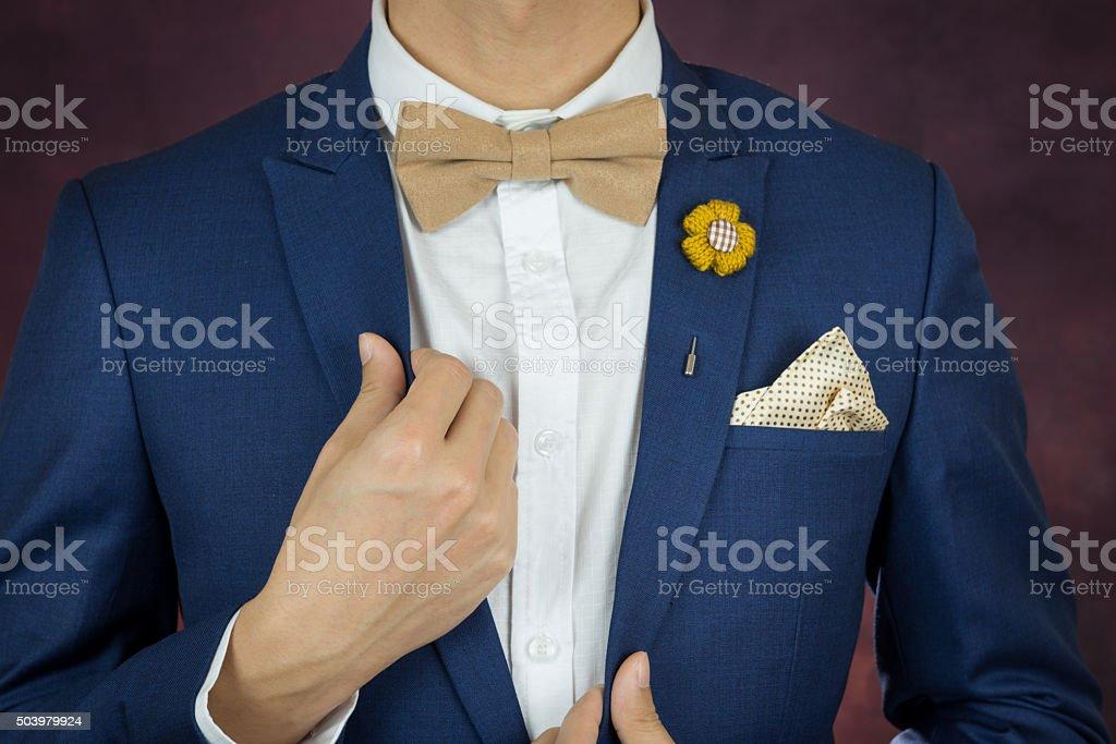 man in blue suit bowtie, brooch, handkerchief stock photo