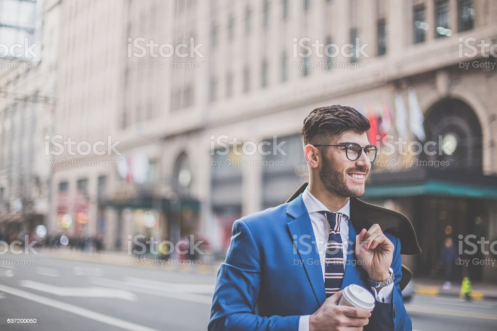 Man in blue suit stock photo