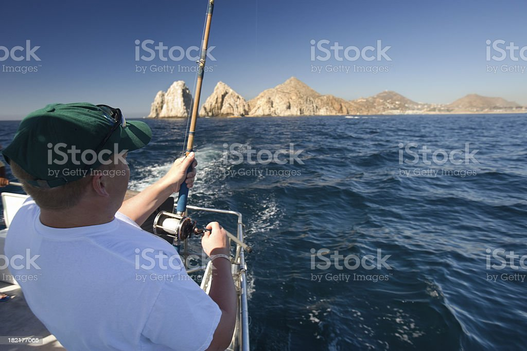 Man in boat deep sea fishing, Cabo San Lucas. stock photo