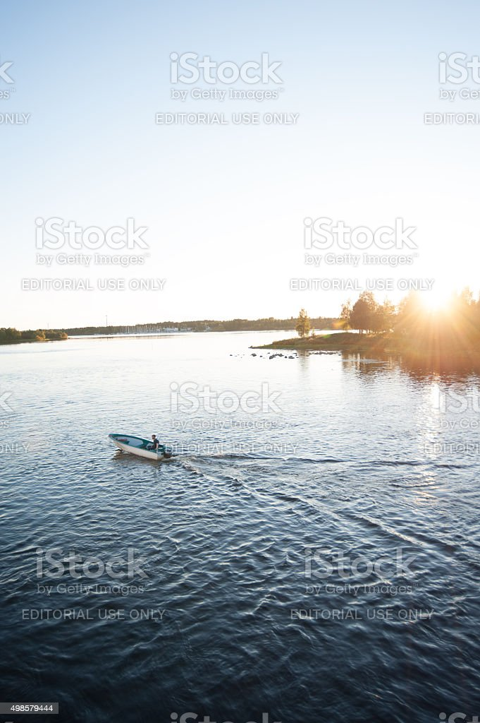 Man in boat on the Oulu joki river in Finland stock photo