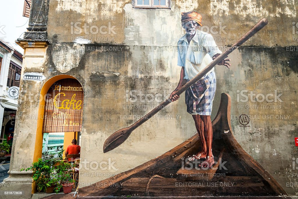 Man in boat with oar. Street art, George town stock photo