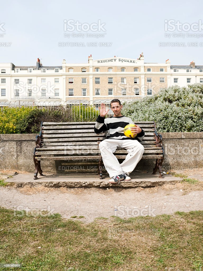 Man in Brighton Park, UK stock photo