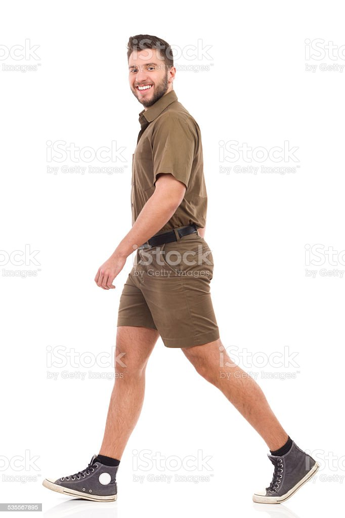 Man in brown uniform walking stock photo