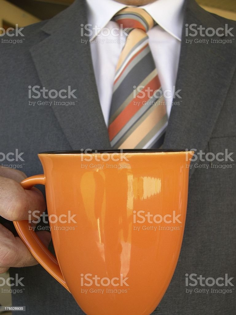 man in business suit holding coffee cup royalty-free stock photo