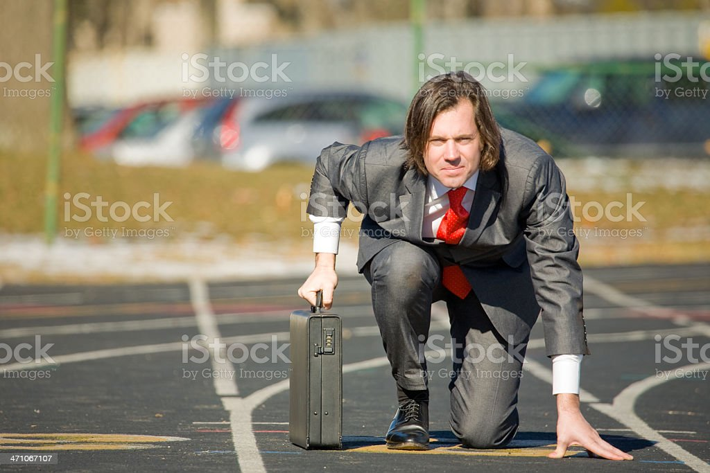 Man in Business Suit on running track royalty-free stock photo
