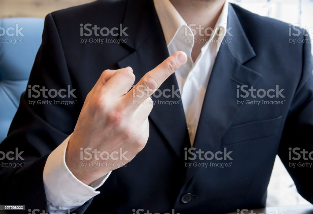 Man in business suit showing middle finger fuck stock photo