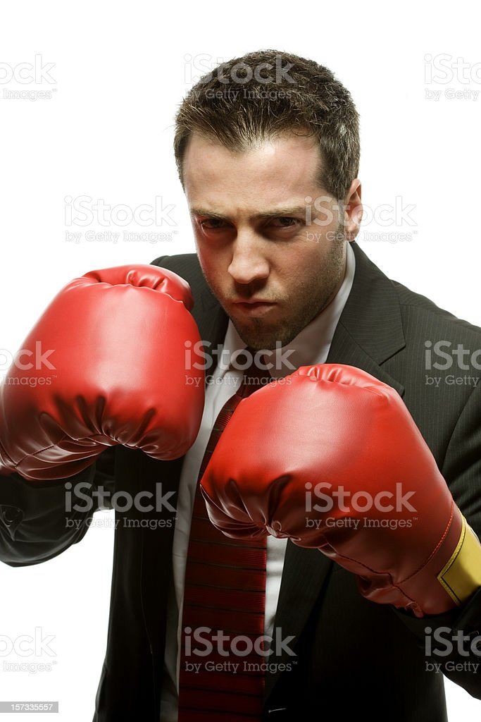 Man in Business suit with Boxing gloves. stock photo