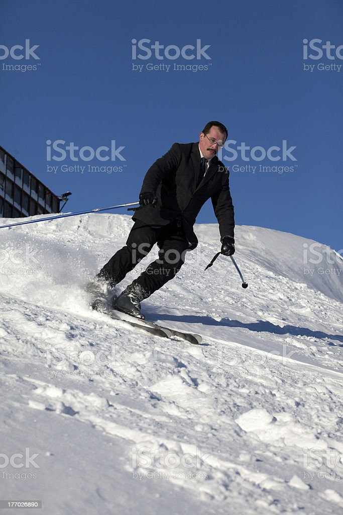 Man in business sute on ski royalty-free stock photo