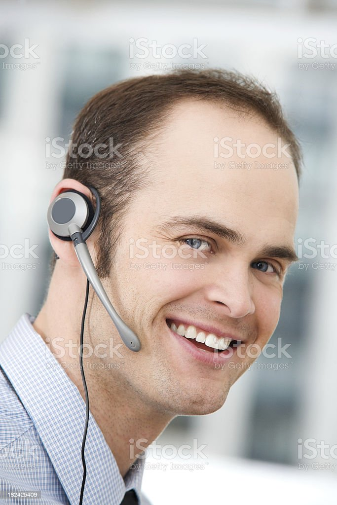 Man in Call Center with Headset stock photo