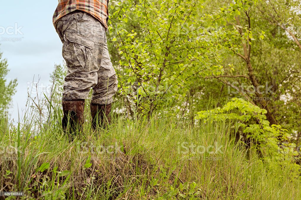 man in camouflage trousers stock photo