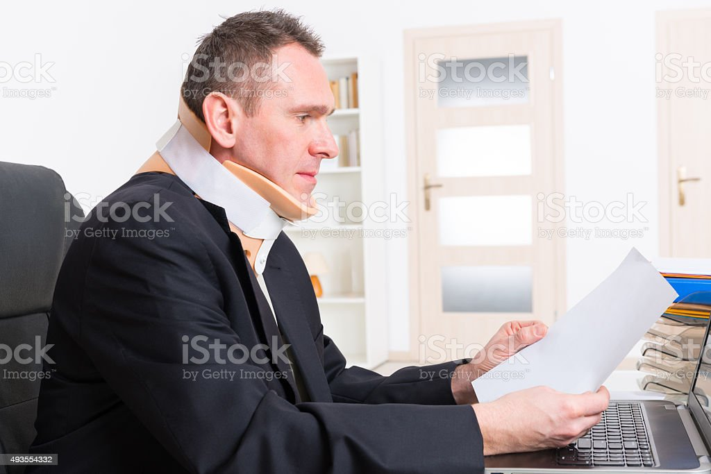 Man in cervical collar stock photo