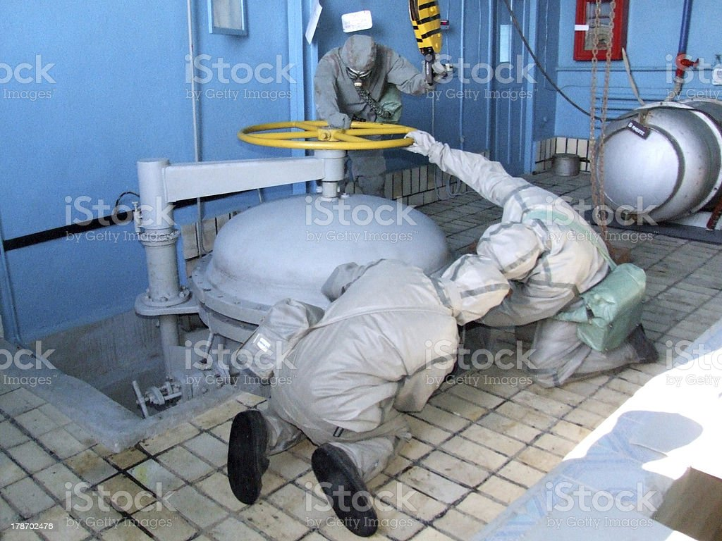 man in  chemical suit stock photo