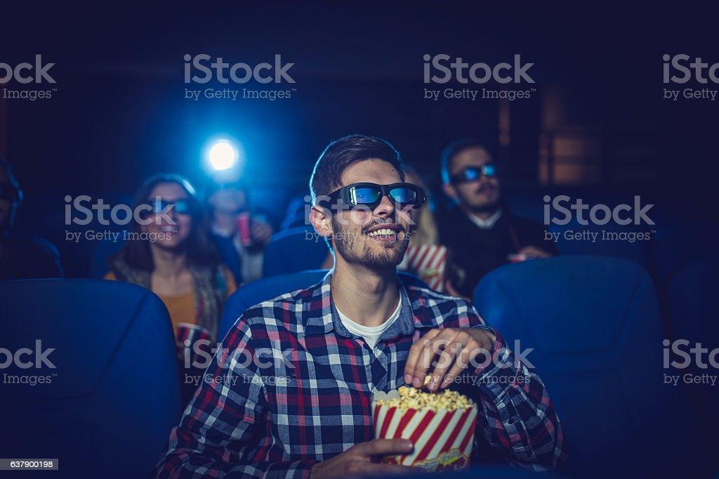 Man in cinema stock photo