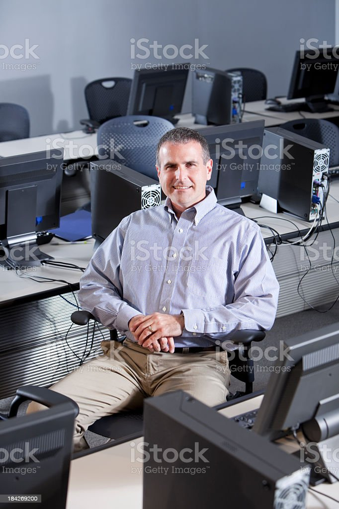 Man in computer lab stock photo