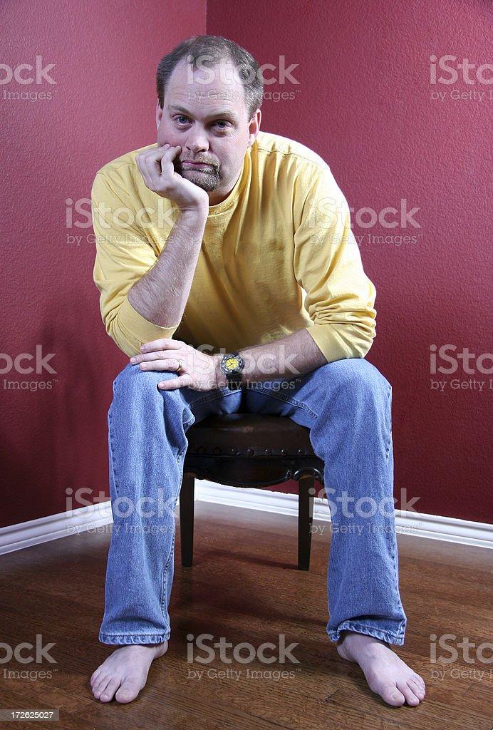 Man in Corner stock photo