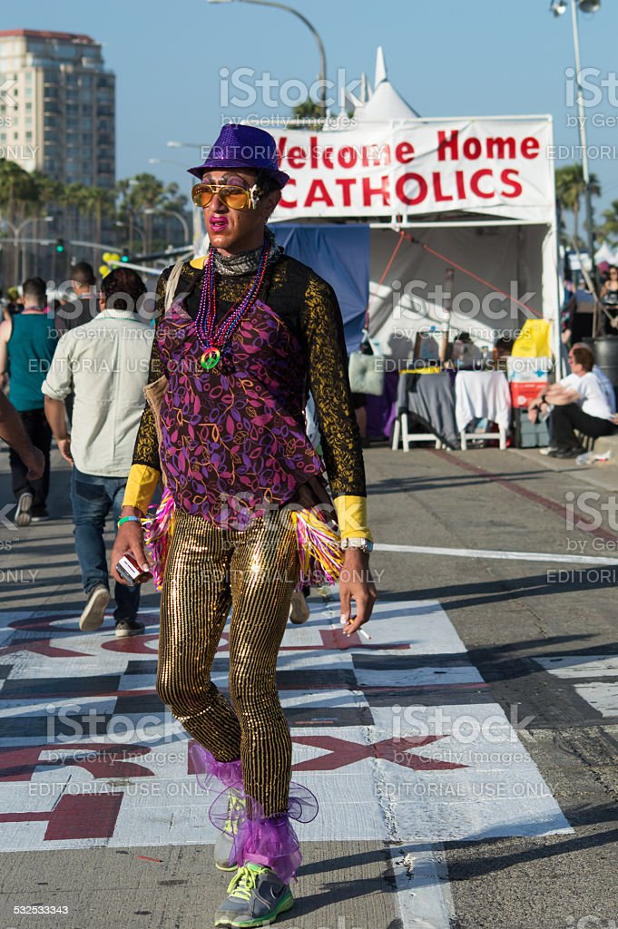 Man in costume walking at pride festival stock photo