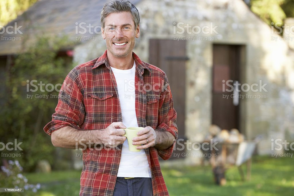 Man in country garden stock photo