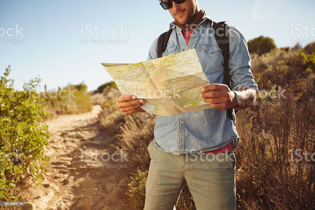 Man in countryside with a map stock photo