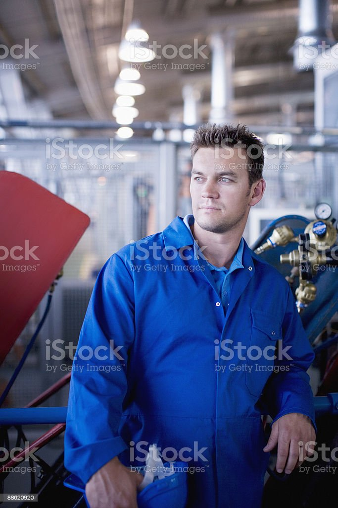 Man in coveralls in workshop royalty-free stock photo