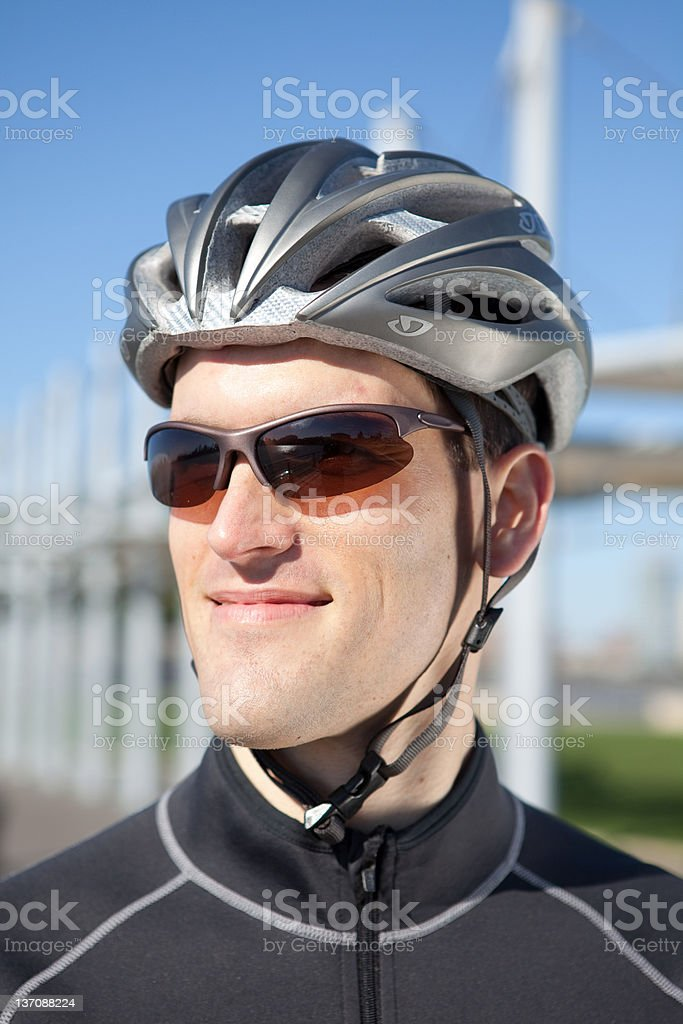Man in cycling gear smiling confidently stock photo