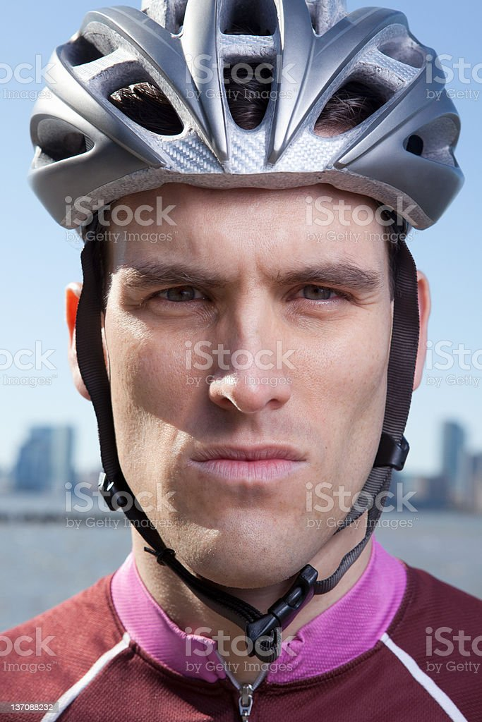 Man in cycling helmet looking straight ahead stock photo