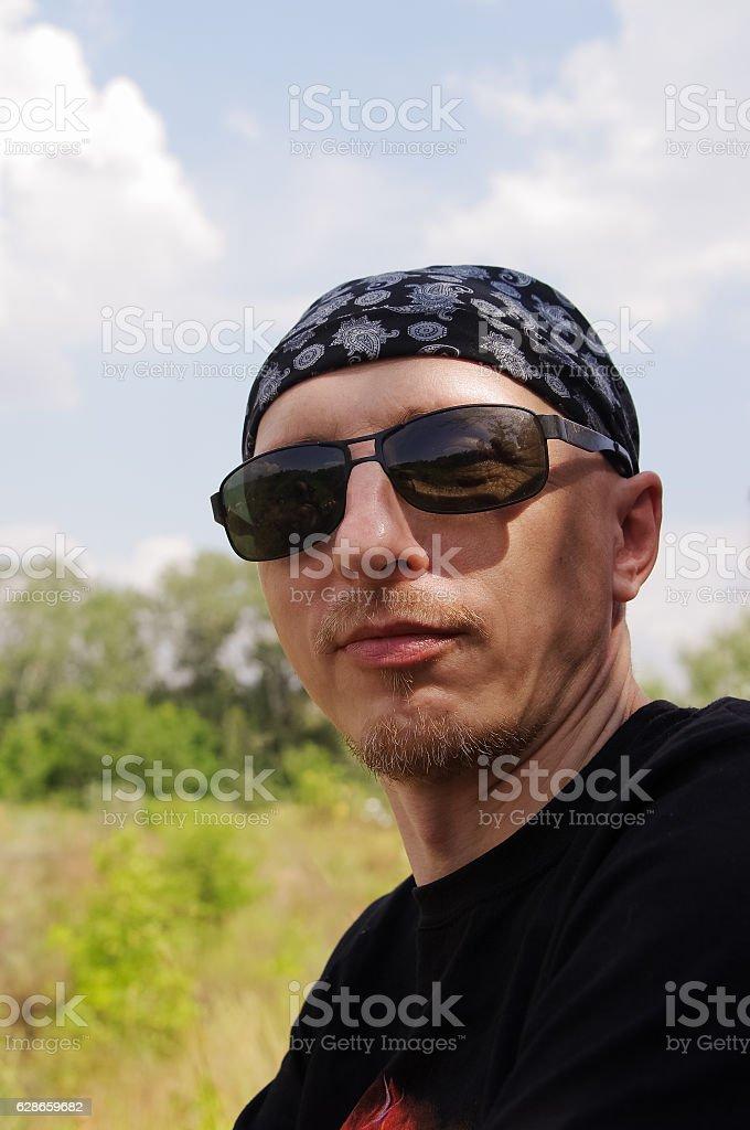 Man in dark glasses and bandana on his head stock photo