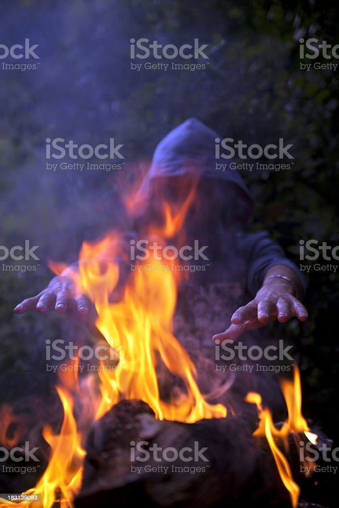 Man in darkness near the campfire royalty-free stock photo
