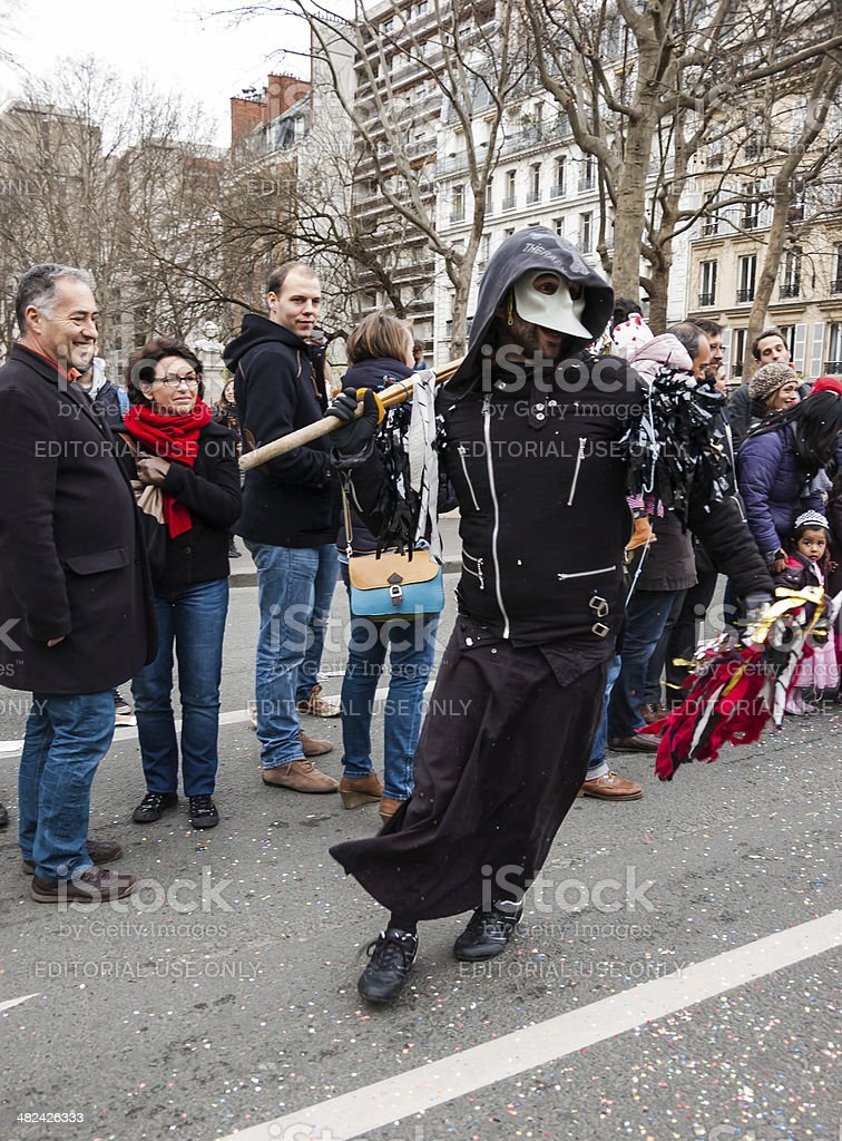 Man in Death costume with scythe at Carnival of Paris. royalty-free stock photo