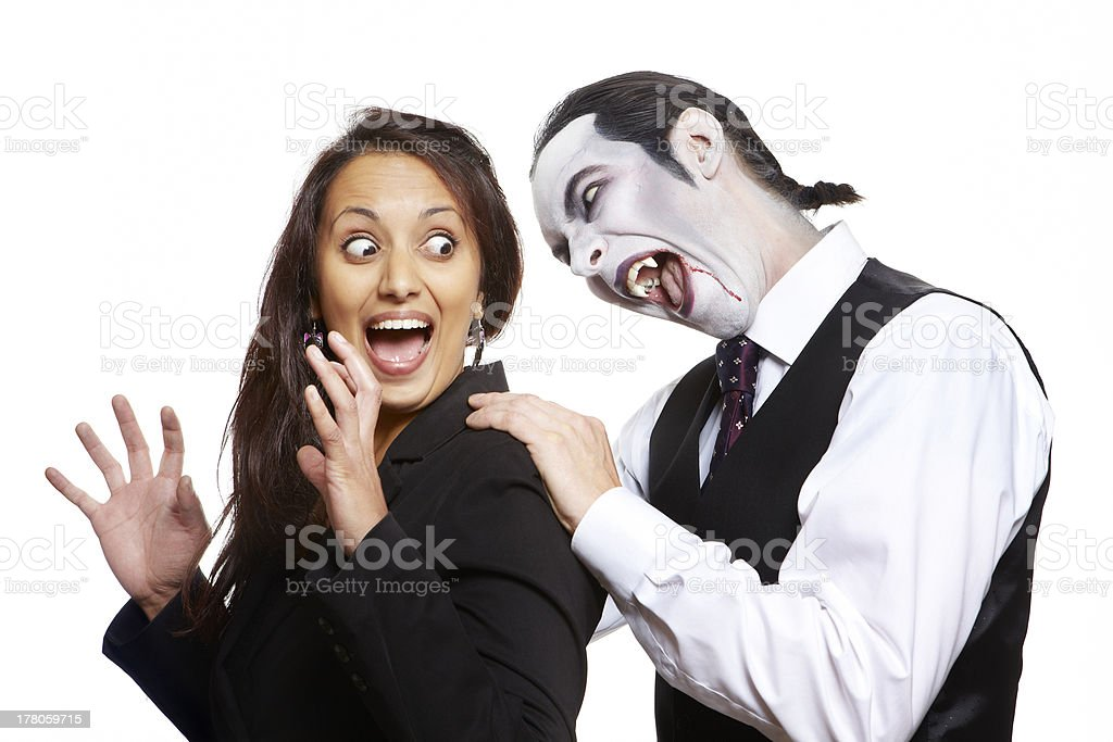 Man in dracula fancy dress costume biting girls neck royalty-free stock photo