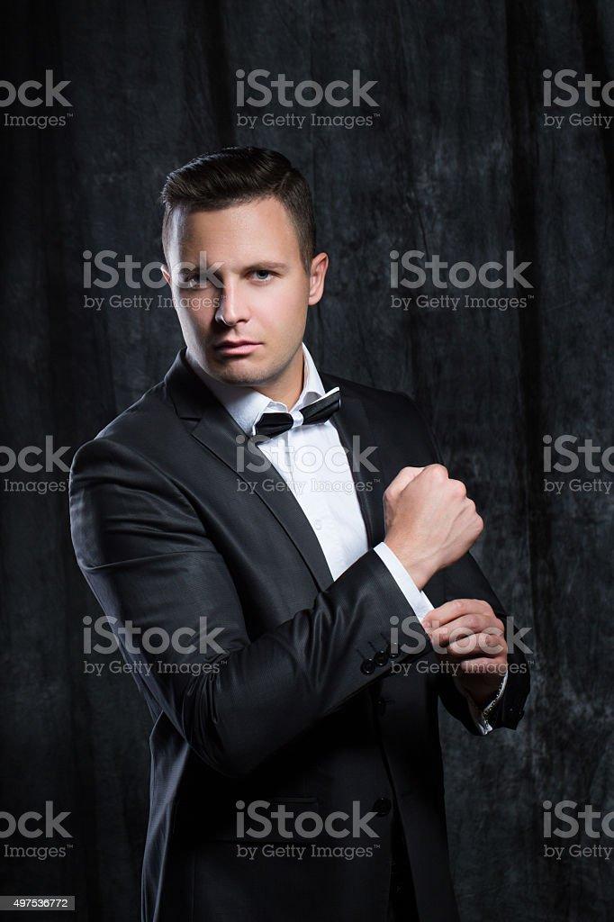 Man in elegant black suit. stock photo