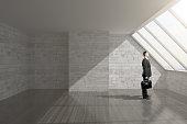 Man in empty interior