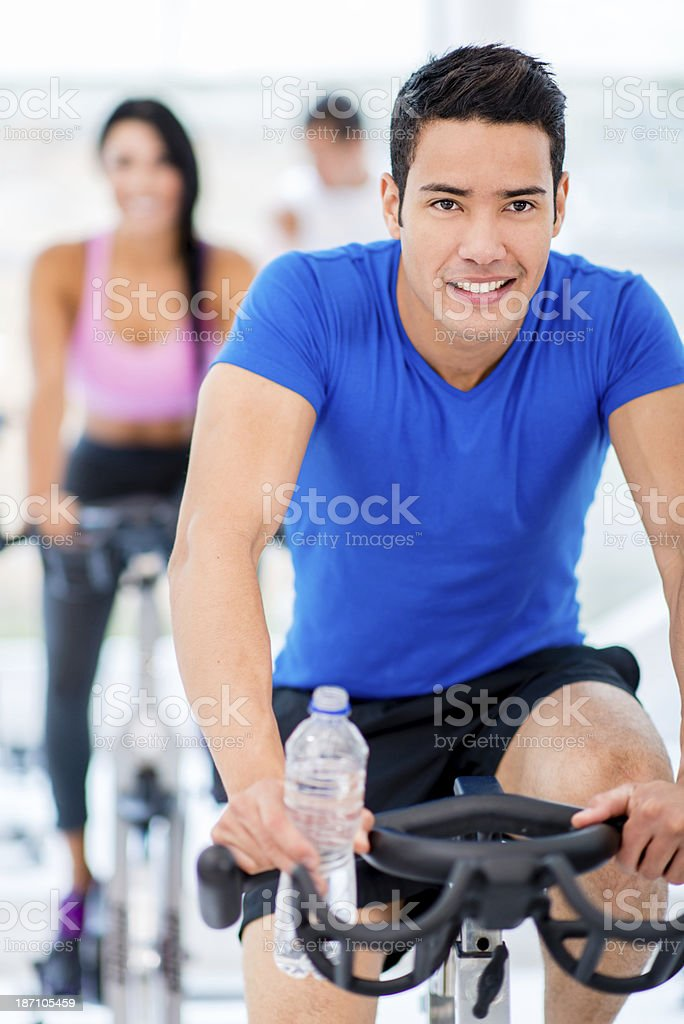 Man in spinning class royalty-free stock photo