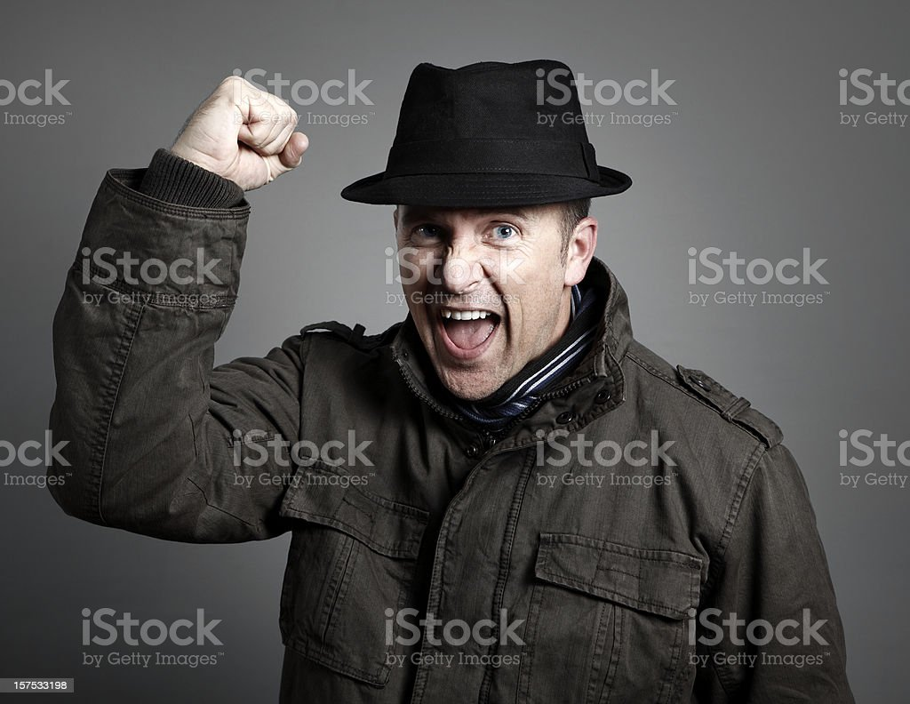 Man in Fedora Cheering royalty-free stock photo