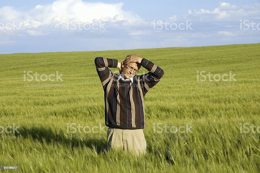 Man in Field – Now what? royalty-free stock photo