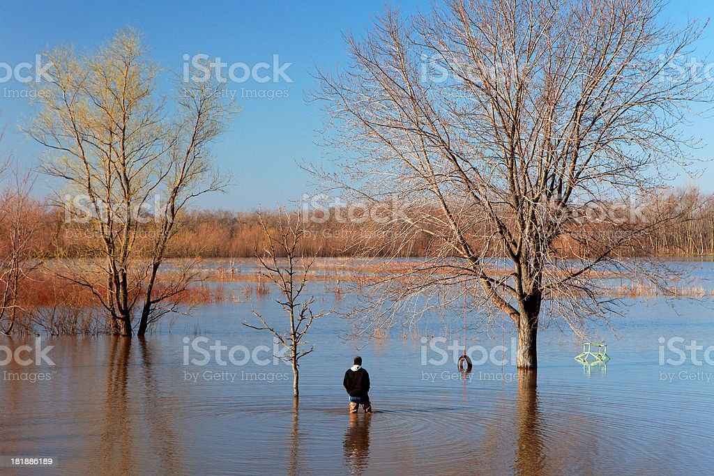 Man in flooded yard royalty-free stock photo
