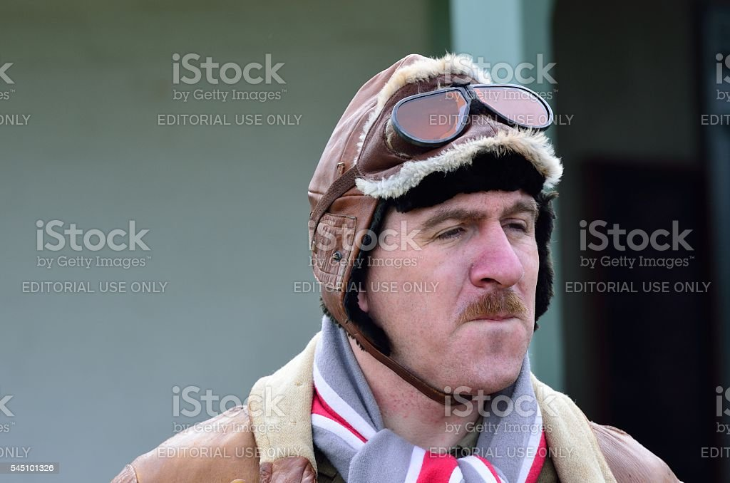 Man in  flying hat  recreating uniform of RAF stock photo