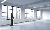 man in formal suit who is looking out the window