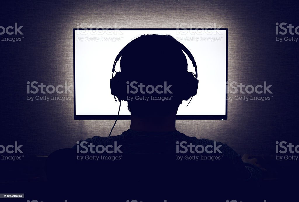 Man in front of a blank monitor stock photo