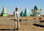 Man in front of muslim mausoleums, Sudan