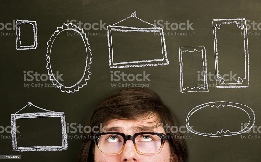 Man in front of painted frames on a blackboard. royalty-free stock photo