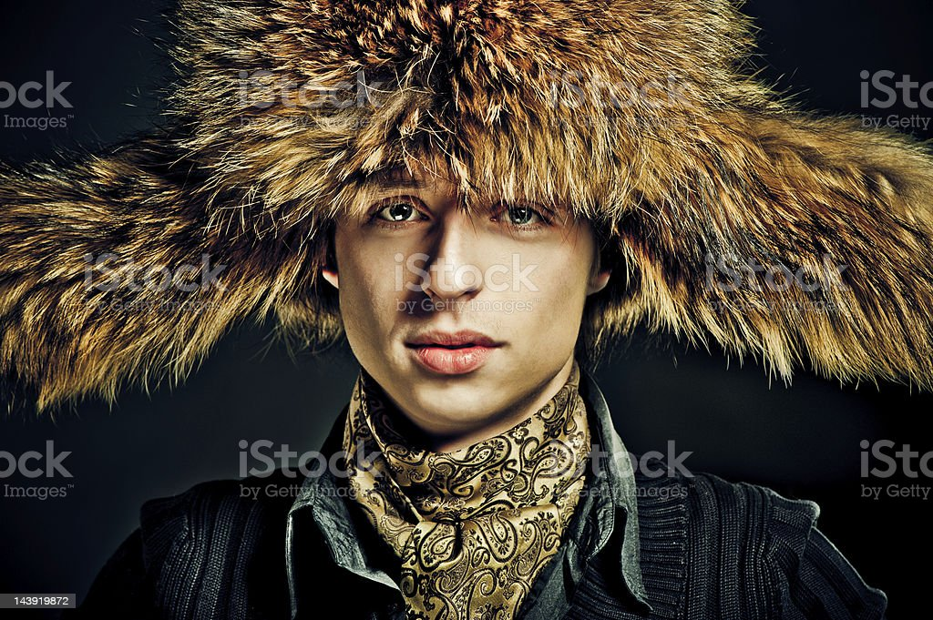 Man in furry hat stock photo