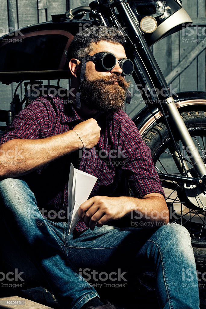 Man in glasses with paper plane stock photo