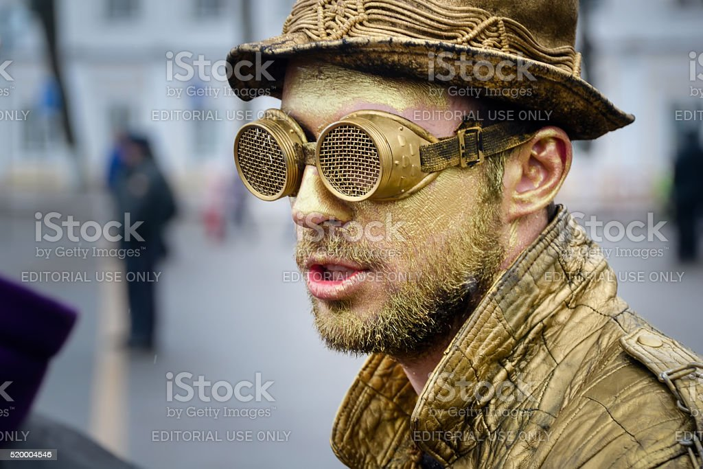 Man in gold paint on carnival stock photo