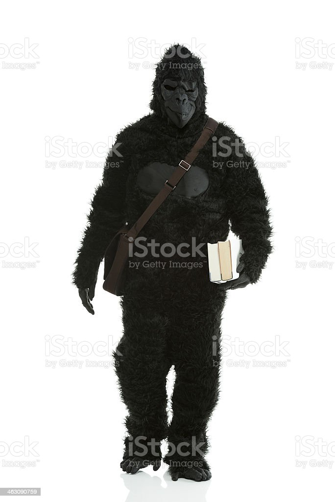 Man in gorilla costume walking with bag on shoulders royalty-free stock photo