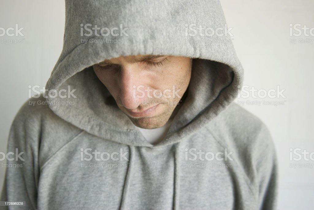Man in Gray Hoody Looks Down royalty-free stock photo